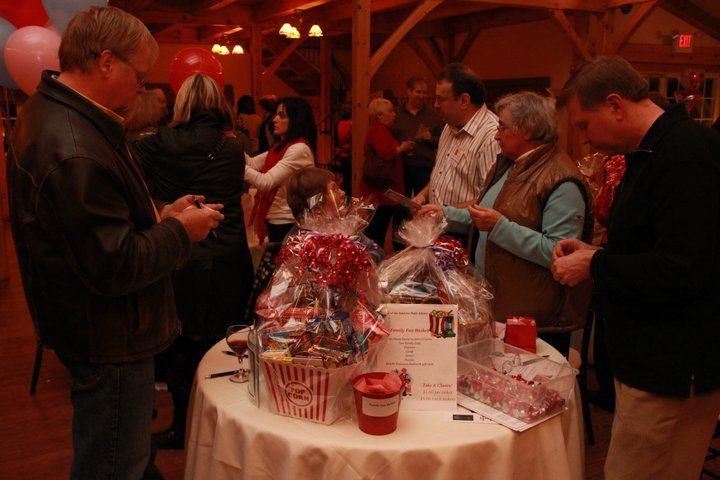 Looking at items on the charity table.
