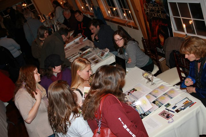Looking at the different books for sale at the Author's Night at the Vineyard.